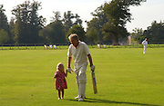Derek Bell and his granddaughter Countess Tatiana Ignatieff, The Duke of Richmond and Gordon's X1 V The Earl of March and Kinrara's X1. Cricket match before the Goodwood Revival meeting, 2 September 2004. SUPPLIED FOR ONE-TIME USE ONLY-DO NOT ARCHIVE. © Copyright Photograph by Dafydd Jones 66 Stockwell Park Rd. London SW9 0DA Tel 020 7733 0108 www.dafjones.com