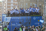 Brighton players on open top bus parade trophy during the Brighton & Hove Albion Football Club Promotion Parade at Brighton Seafront, Brighton, United Kingdom on 14 May 2017. Photo by Phil Duncan.