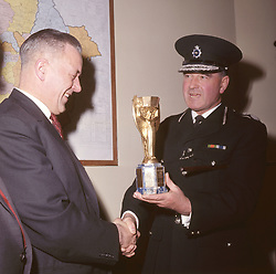 File photo dated 28/3/1966 of the recovered World Cup trophy viewed by Detective Chief Inspector William Little (left) and District Commander John Lawlor at Cannon Row police station, London. A London gangster and his brother were behind the notorious unsolved theft of the World Cup trophy just months before the 1966 tournament in England, it has been claimed.