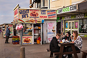 Greesy Joes burger bar on the promenade, 21st April 2021 in Blackpool, Lancashire, United Kingdom. Family-run since 1966. Blackpool is a large town and seaside resort in the county of Lancashire on the north west coast of England. Blackpool was once a booming resort with it's famous promenade which now, despite having a somewhat shabby appearance, still continues to attract millions of visitors each year. During the coronavirus pandemic however, Blackpool has struggled, with empty streets and closed down businesses creating an atmosphere more like a ghost town.