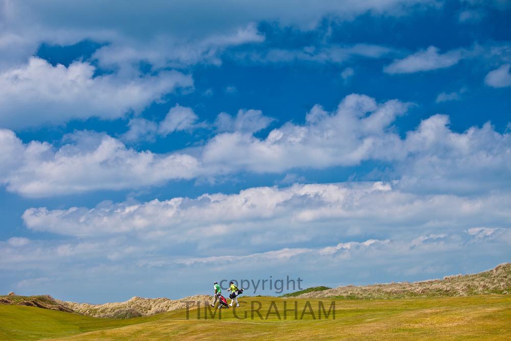 Golfers at Doonbeg Golf Club, County Clare, West of Ireland