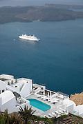 A cruise ship in the bay seen from Imerovigli, balcony to the Aegean, an area in Fira village, Santorini, Greece
