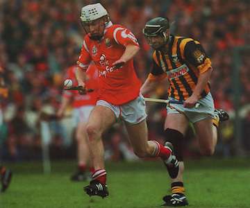 Timmy McCarthy races clear of Kilkenny's Peter Barry in the 1999 Final.