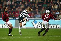 Milano 1/11/2003 <br />Milan Juventus <br />Pavel Nedved (Juventus) tra Andrea Pirlo e Alessandro Nesta (Milan)<br />Pavel Nedved (Juventus) between Andrea Pirlo and Alessandro Nesta (Milan)<br />Foto Baroncini/Graffiti