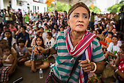 "15 JUNE 2014 - BANGKOK, THAILAND: A woman dances while a police band performs in Lumpini Park in Bangkok. The Thai military junta, formally called the National Council for Peace and Order (NCPO), is sponsoring a series of events throughout Thailand to restore ""Happiness to Thais."" The events feature live music, dancing girls, military and police choirs, health screenings and free food.   PHOTO BY JACK KURTZ"