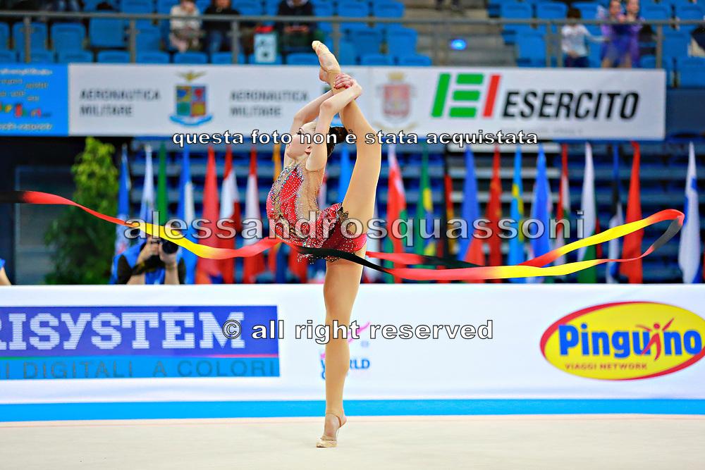 Ashirbayeva Sabina during qualifying at ribbon in Pesaro World Cup 11 April 2015.<br /> Sabina born on November 5, 1998 in Shymkent, she is an individual Kazakh rhythmic gymnast.
