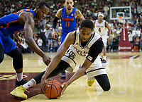 Texas A&M center Tonny Trocha-Morelos (10) goes after a loose ball while Florida forward Keith Stone (25) defends during the first half of an NCAA college basketball game Tuesday, Jan. 2, 2018, in College Station, Texas. (AP Photo/Sam Craft)