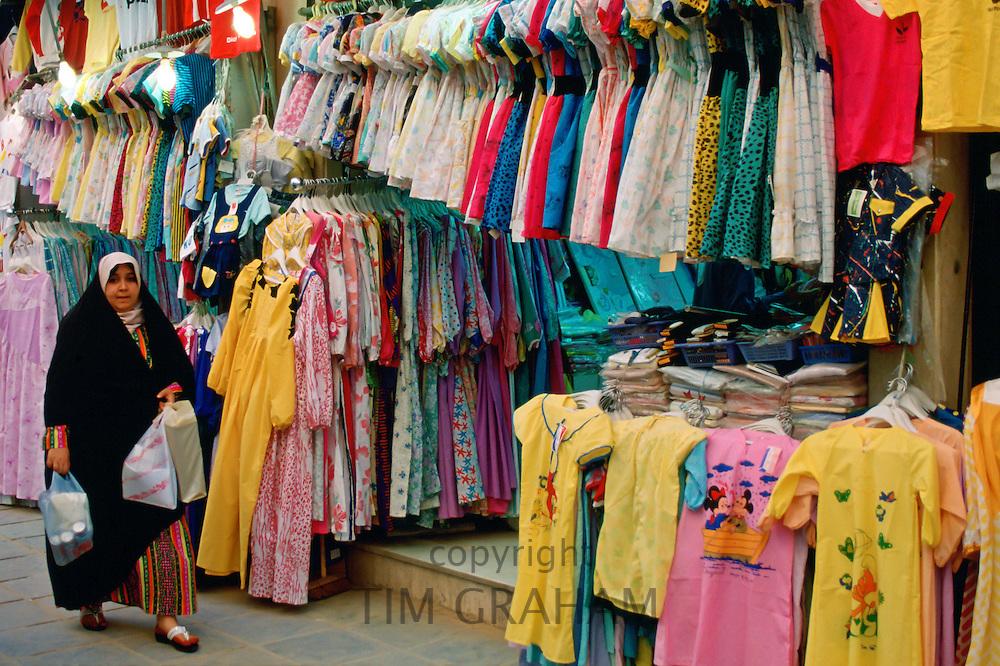 Woman wearing abaya  while shopping in souk, Kuwait City