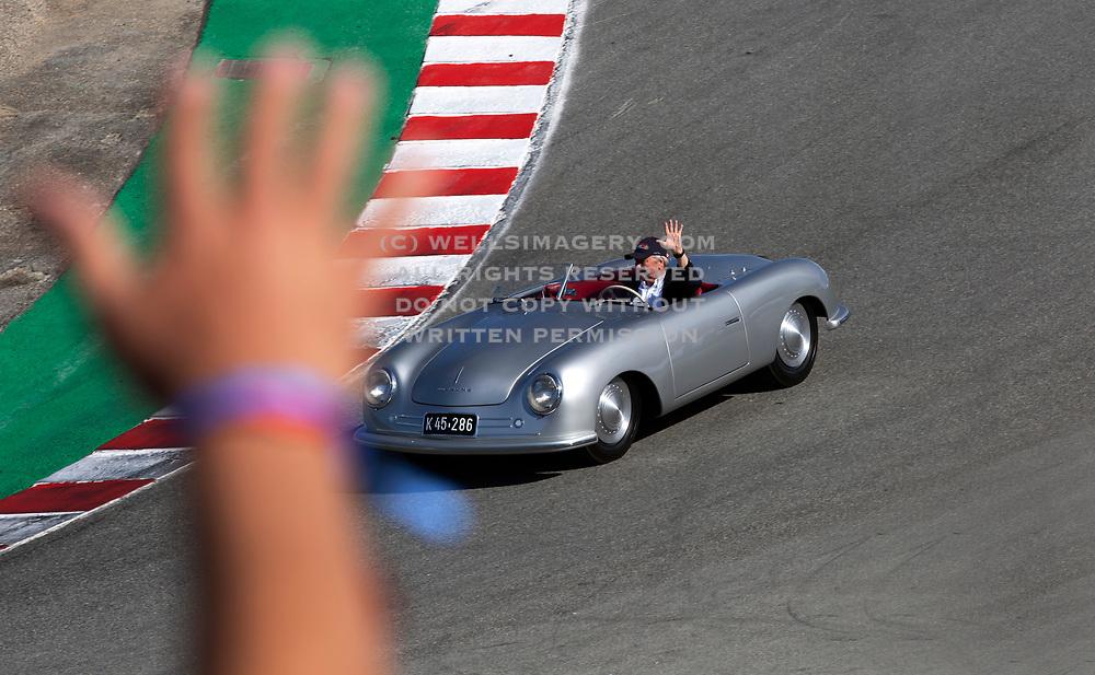 Image of Wolfgang Heinz Porsche driving the first Porsche 356 ever built, at the Corkscrew of Weathertech Raceway Laguna Seca during Rennsport Reunion VI, Monterey, California, America west coast by Randy Wells