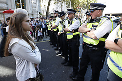 © Licensed to London News Pictures. 20/09/2019. London, UK. Activists taking part in the Global Climate Strike demonstration face a line of police blocking the road near Trafalgar Square. Thousands of similar actions are taking place all over the UK and the rest of the world. Photo credit: Peter Macdiarmid/LNP