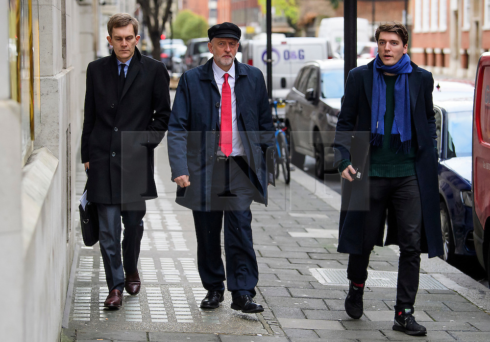 """© Licensed to London News Pictures. 10/01/2017. London, UK. Labour Party leader JEREMY CORBYN (centre) seen in London with Labour Party's Executive Director of Strategy and Communications SEUMAS MILNE (Left) and JAMES SCHNEIDER of Momentum (right) , on the day he is due to give a speech on Brexit, arguing that the UK """"can be better off"""" after leaving the EU. Photo credit: Ben Cawthra/LNP"""