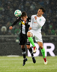 MOENCHENGLADBACH, March 3, 2018  Robert Bauer (R) of Bremen heads the ball with Thorgan Hazard of Moenchengladbach during the Bundesliga match between Borussia Moenchengladbach and SV Werder Bremen at Borussia-Park in Moenchengladbach, Germany, on March 2, 2018.  The match ended with a 2-2 draw. (Credit Image: © Ulrich Hufnagel/Xinhua via ZUMA Wire)