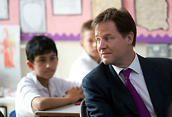 © London News Pictures. 17/07/2013. London, UK.  Deputy Prime Minister NICK CLEGG listens  year 6 lesson during a visit to St Joseph's Primary School, in Holborn, London. The Government today (17/07/2013) announced plans to rank students nationally at the age of 11.  Photo credit : Ben Cawthra/LNP