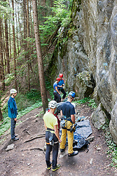 Group of climbers preparing for rock climbing, Sautens, Otztal, Tyrol, Austria