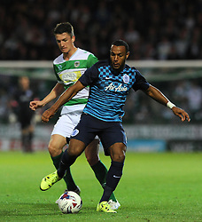 QPR's Matt Phillips is tackled by Yeovil Town's Alex Lacey - Photo mandatory by-line: Harry Trump/JMP - Mobile: 07966 386802 - 11/08/15 - SPORT - FOOTBALL - Capital One Cup - First Round - Yeovil Town v QPR - Huish Park, Yeovil, England.