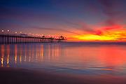 Huntington Beach at Sunset Pier Stock Photo
