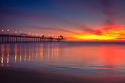 Huntington Beach at Sunset Pier Stock Photo