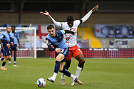 Wycombe Wanderers forward Anis Mehmeti (33) battles for possession with Luton Town forward Elijah Adebayo (29) during the EFL Sky Bet Championship match between Wycombe Wanderers and Luton Town at Adams Park, High Wycombe, England on 10 April 2021.
