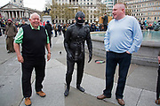 Stag party humiliation pranks as the groom is dressed up in a gimp costume and pushed into the fountains in Trafalgar Square in London, England, United Kingdom. There is a strong tradition at the British Stag Do, to play tricks on the stag at least once. In this case, he had no idea where he was headed, and so blindfolded was perched on the waters edge and thrown in. The stag seemed not to mind but was also, somewhat the worse for wear.
