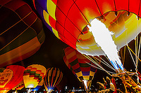 Evening balloon glow at Rio West Mall, during the Red Rock Balloon Rally, Gallup, New Mexico USA.