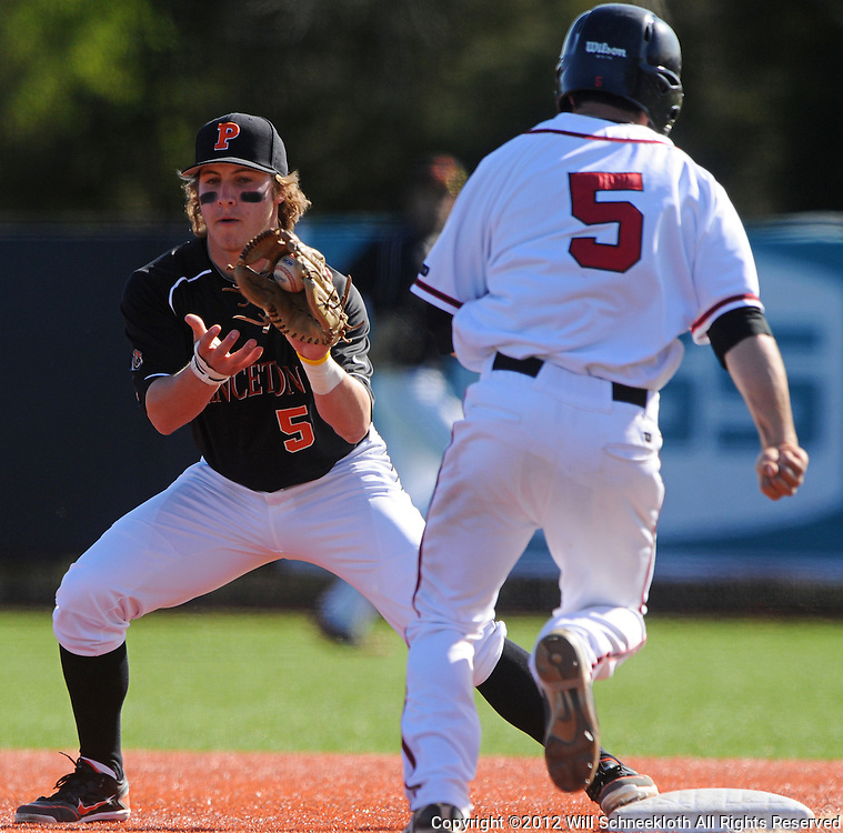 Priceton first baseman Alex Flink steps on the base to punch out Rutgers second baseman Nick Favatella (#5 white) as Rutgers defeats Princeton 12-11 in NCAA college baseball on a walk-off home run at Bainton Field in Piscataway, N.J.