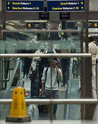 © Licensed to London News Pictures. 15/08/2020. London, UK. Travellers from France arrive at the Eurostar terminal at St Pancras International after France was removed from the list of safe countries people can travel to without going into quarantine. From 4am this morning (Sat) anybody returning to the UK from France will be required to self isolate for two weeks, following an increase in Covid-19 cases in France. Photo credit: Ben Cawthra/LNP