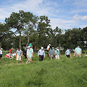 Jason Day, Australia, along with staff and officials look for his ball in the rough after a wayward shot of the 13th hole during the third round of theThe Barclays Golf Tournament at The Ridgewood Country Club, Paramus, New Jersey, USA. 23rd August 2014. Photo Tim Clayton