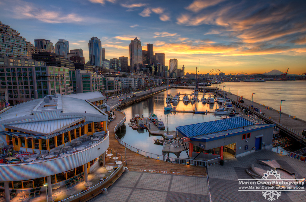 Sunrise along the Seattle waterfront, with Mt. Rainier in the background.