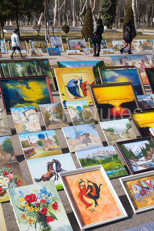 Colourful artwork on sale at Independence Square on 1st March 2014 in Tashkent, Uzbekistan.