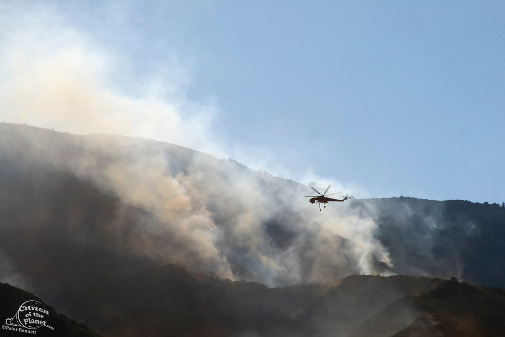 Helicopter drop water on Sylmar wildfire, Novermber 2008, California, USA