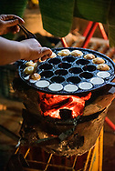 Mini coconut pancakes made and sold on the street in Luang Prabang, Laos.