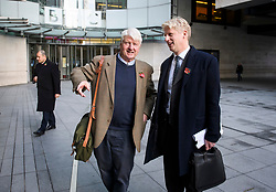 """© Licensed to London News Pictures. 10/11/2018. London, UK. JO JOHNSON MP and his father STANLEY JOHNSON leave BBC Broadcasting House in London after JO JOHNSON resigned as transport minister yesterday. Mr Johnson, brother of former foreign secretary Boris Johnson, resigned his ministerial post saying it's """"imperative we go back to the people and check"""" they still want to leave. Photo credit: Ben Cawthra/LNP"""