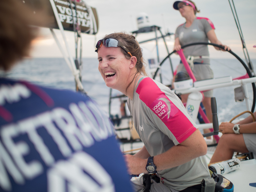 January 17, 2015. Day 14 of Leg 3 to Sanya, onboard Team SCA. Stacey Jackson has a good laugh at a joke.