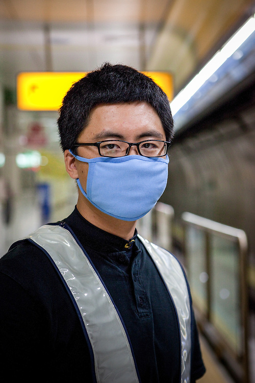"""Portrait of a security guard with face mask at the Daegu subway station """"Igok""""."""
