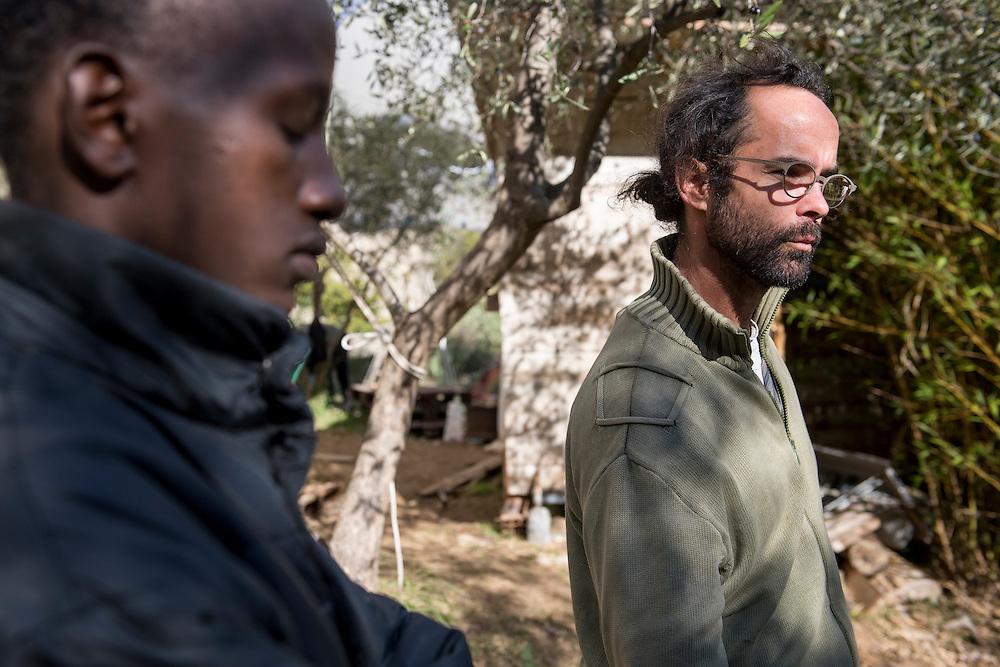 November 8, 2016 - Breil-sur-Roya, France: Cedric Herrou, a 37-year-old farmer, with a migrant he houses on his farm. Cedric is one of the 120 inhabitants of the village Breil-sur-Roya in the Roya valley, in the Alps on the French Italian border, who formed a network to help migrants who walked into the valley from Ventimiglia, Italy, with shelter, food and transportation.<br /> <br /> 8 novembre 2016 - Breil-sur-Roya, France: Cedric Herrou, agriculteur de 37 ans, avec un migrant érythréen qu'il héberge dans sa ferme. Cédric est l'un des 120 habitants du village de Breil-sur-Roya dans la vallée de la Roya, à la frontière italienne, qui aident des migrants.
