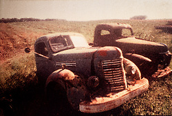 Polaroid transfer, two abandoned rusting trucks in field. CONCEPT STOCK PHOTOS CONCEPT STOCK PHOTOS