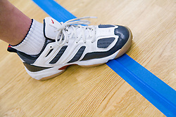 Close up of a team member's foot on tactile markings of indoor court area which helps the player determine their position during Goalball; a threeaside game developed for the visually impaired and played on a volleyball court,