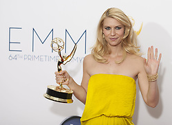 Sept. 23, 2012 - Los Angeles, California, U.S. - Actress CLAIRE DANES poses in the press room at the 64th Annual Primetime Emmy Awards held at the Nokia Theatre. Danes, who won the Emmy for Lead Actress in a Drama for her role in 'Homeland,' wears a bright yellow strapless Lanvin gown. (Credit Image: © Armando Arorizo/Prensa Internacional/ZUMAPRESS.com)