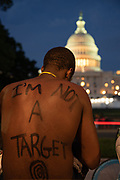 Jared Adams, 19, sits on the steps across the Capitol during the protest demanding  justice for the death of  unarmed black people in Washington,D.C on May 29, 2020. Admas shares that the writings on his back were done by his little sister. The protests were in demonstration over the death of George Floyd, a black man who died after a white policeman kneeled on his neck for several minutes. Despite the stay at home order due to Covid-19 lot of protesters showed up wearing masks. Photo by Akash Pamarthy