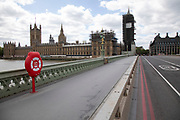 Westminster Bridge looking towards the Houses of Parliament is eerily quiet, devoid of traffic, and silent on empty streets as lockdown continues and people observe the stay at home message in the capital on 11th May 2020 in London, England, United Kingdom. Coronavirus or Covid-19 is a new respiratory illness that has not previously been seen in humans. While much or Europe has been placed into lockdown, the UK government has now announced a slight relaxation of the stringent rules as part of their long term strategy, and in particular social distancing.