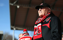 Fleetwood Town fan looks on before the game