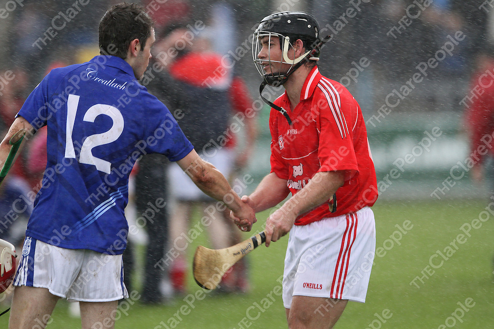 Cratloe's Damien congratulates David Forde Crusheen in a downpour at the end of the Clare Co. Final 2010. - Photograph by Flann Howard
