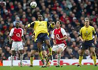 Photo: Scott Heavey.<br />Arsenal v Bolton. FA Barclaycard Premiership. 20/03/2004.<br />Jay-Jay Okocha controls on the chest