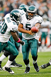 Philadelphia Eagles quarterback Donovan McNabb #5 hands the ball off during the NFL game between the Philadelphia Eagles and the Oakland Raiders. The Raiders won 13-9 at The Oakland-Alameda County Coliseum in Oakland, California. (Photo By Brian Garfinkel)