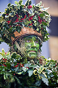 A performer dressed as the Green Man (also known as  the Holly Man) from The Lions Part company acts in an annual traditional free theatre celebrating a 'wassail' celebration to herald the new year. Bankside, London, UK. To celebrate the New Year, actors (The Bankside Mummers) associated with the Lion's Part company from the Globe Theatre, perform in traditional costume and entertain the crowds by the Thames. Participants dressed as St George and the Holly Man in the winter guise of the Green Man (a traditional pagan nature symbol) lead a procession through the streets toasting the seasons.
