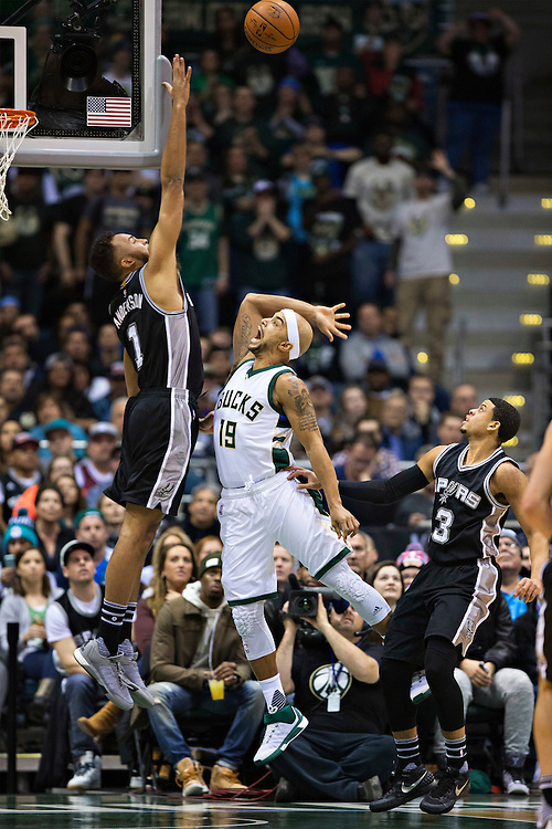 """MILWAUKEE, WI- JANUARY 4:  Jerryd Bayless #19 of the Milwaukee Bucks takes a shot over Kyle Anderson #1 of the San Antonio Spurs at BMO Harris Bradley Center on January 4, 2016 in Milwaukee, Wisconsin.  """"NOTE TO USER: User expressly acknowledges and agrees that, by downloading and or using this photograph, User is consenting to the terms and conditions of the Getty Images License Agreement.""""(Photo by Wesley Hitt/Getty Images) *** Local Caption *** Jerryd Bayless; Kyle Anderson"""
