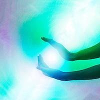 Hands in light energy.