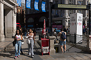 With a further 89 UK covid victims in the last 24hrs, bringing the total victims to 43,995 during the Coronavirus pandemic, shops continue opening along Londons Oxford Street where social distance and hygiene advice towers are located for shoppers to observe restriction rules, on 2nd July 2020, in London, England.