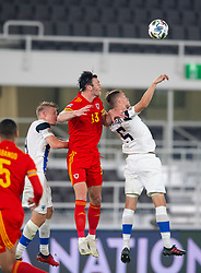 HELSINKI, FINLAND - Thursday, September 3, 2020: Wales' Kieffer Moore (C) wins a header from Finland's Leo Väisänen (R) during the UEFA Nations League Group Stage League B Group 4 match between Finland and Wales at the Helsingin Olympiastadion. Wales won 1-0. (Pic by Jussi Eskola/Propaganda)