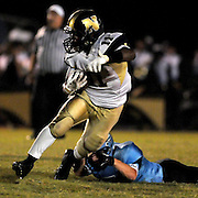 North Brunswick High School's Shack Graham rushes against South Brunswick High School's Ian Tenenoff Friday September 13, 2013. (Jason A. Frizzelle)
